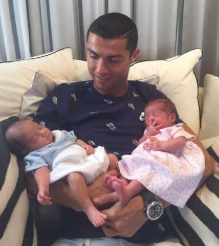 BABA IBEJI: Ronaldo Poses With His Twin Babies After Confed Cup Heartache