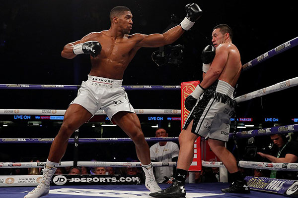 Ex-World Champion Lewis Defends Joshua's Style Vs Parker, Wants Wilder Fight