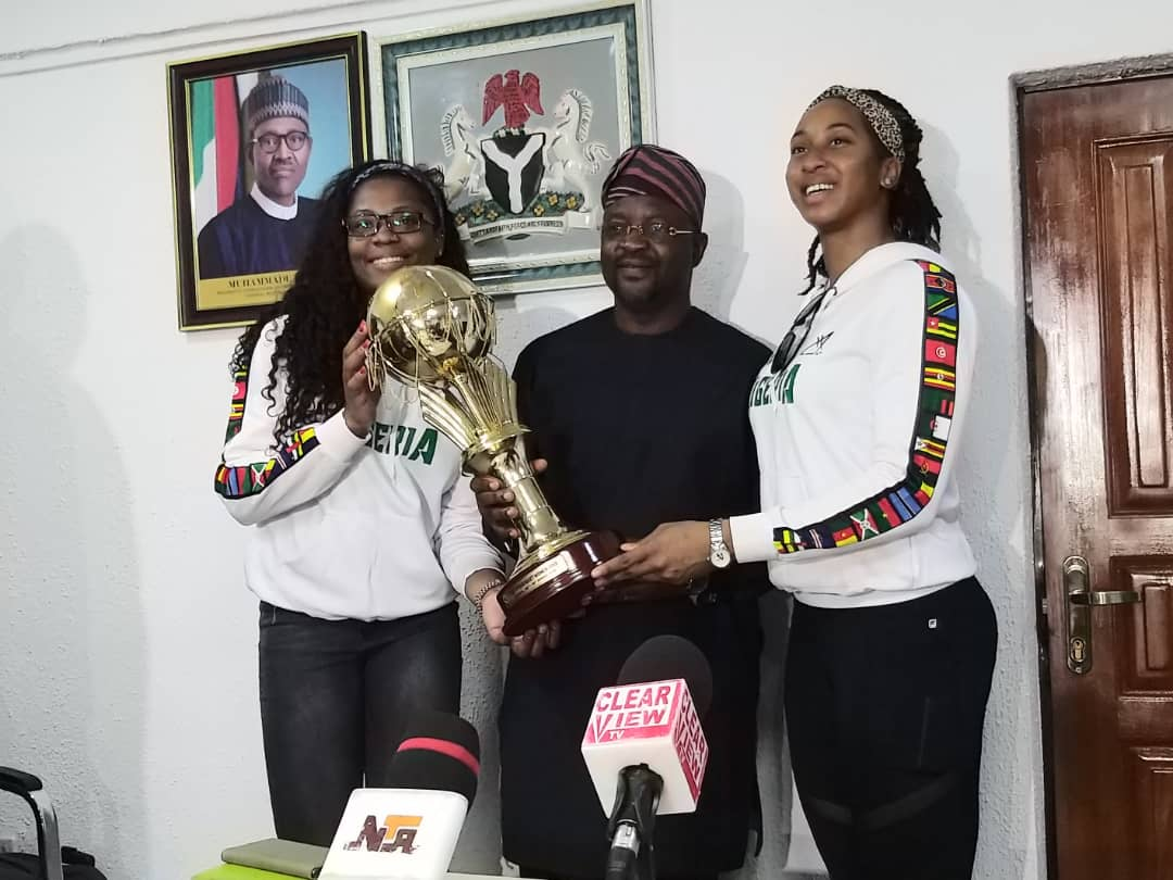 Sports Minister Dare Receives Afrobasket Trophy From D'Tigress, NBBF; Promises More Support