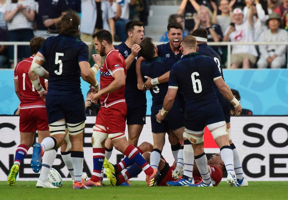 Scots Hammer Russia To Set Up Japan Showdown